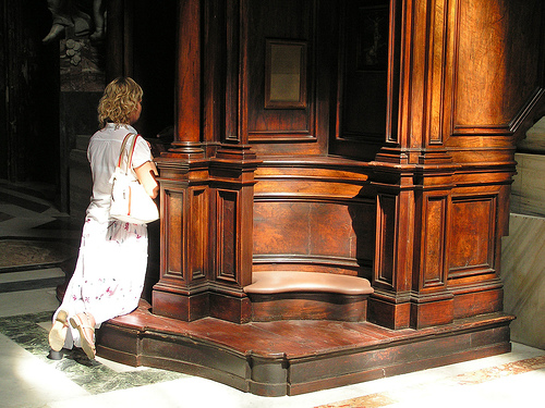 woman kneeling in confession