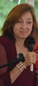 Susie Lloyd speaking with microphone