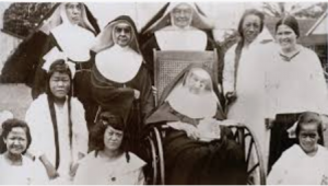 Mother Marianne (seated) with her lepers and fellow Franciscans